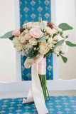 Cute wedding bouquette standing on blue chair. Royalty Free Stock Photos