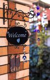 Cute welcome sign on the brick wall royalty free stock images