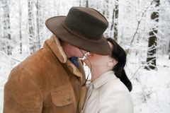 Cute Western Couple. A cute western cowboy couple, kissing in a snow covered landscape Royalty Free Stock Photography