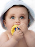 Cute wet baby. With a rubber duck looking up Stock Photos