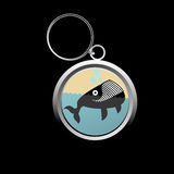 Cute whale key-chain. On black Royalty Free Stock Photos