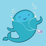 Cute whale with music player Stock Photography