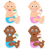 Cute White & Black Infant with Baby Bottle Royalty Free Stock Photos