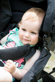 Cute White Blond Baby girl on Stroller Royalty Free Stock Photography