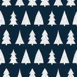 Cute white christmas tree on a dark blue background pattern seam. Less vector Royalty Free Stock Photo