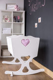 Cute white cradle in nursery room royalty free stock images
