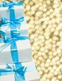 Cute white gift boxes with blue ribbon Stock Photos