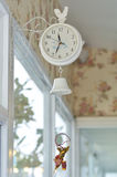 Cute white hanging clock Stock Image