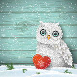 Cute white owl sitting in snow in front of blue wooden wall, winter holiday theme, illustration Royalty Free Stock Photos