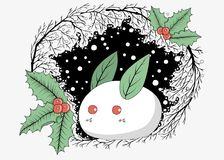 A cute white rabbit made of snow with leaves and holly berries, Royalty Free Stock Images