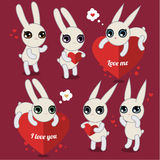 Cute white rabbits on pink Stock Image