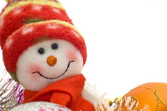 Cute white snowman and Xmas decoration balls Royalty Free Stock Photography