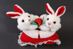 Cute white toy bunnies. Cute withe toy bunnies on gray background Royalty Free Stock Photography