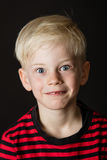 Cute wide eyed little blond boy royalty free stock image