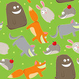 Cute wildlife. Seamless pattern with cute wild animals on a green background Stock Photo