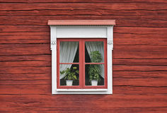 Cute Window on Red Wall Stock Photos