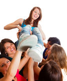 Cute Winner Girl. Team celebrating winner girl picked up in the air Royalty Free Stock Photography