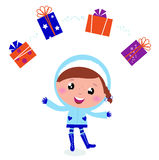 Cute winter child jugglery with christmas gifts. Royalty Free Stock Images