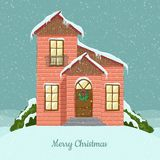 Cute winter house illustration for Christmas, in snowfall. Cute winter house for Christmas, in snowfall, with Christmas wreath decoration on door. Cartoon style Royalty Free Stock Photos