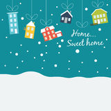 Cute winter houses, covered with snow, hanging on Royalty Free Stock Photos