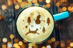 Cute winter pattern in a Cup on the milk foam cappuccino coffee. Merry Christmas. Cute winter pattern in a Cup on the milk foam cappuccino coffee. Christmas mood royalty free stock images