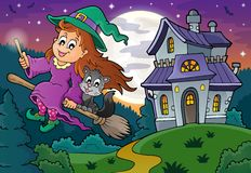 Cute witch on broom near haunted house Royalty Free Stock Image