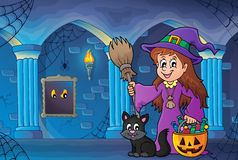 Cute witch and cat in haunted castle Stock Photo