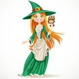 Cute witch with a familiar owlet Stock Photos