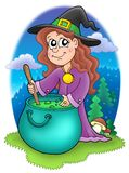 Cute witch with kettle Stock Images