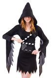 Cute witch with movie board Royalty Free Stock Images