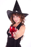 Cute witch offering glass of potion Royalty Free Stock Photos