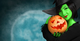 Cute witch with pumpkin royalty free stock photo