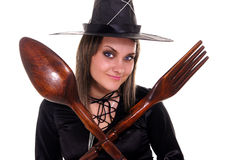 Cute witch with spoon and fork Royalty Free Stock Photography