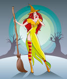 Cute witch stands with a broom in the moonlight on the eve of Halloween. Beautiful cute witch grinning slyly laughing, night stands with a broom on a background Stock Photo
