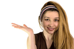 Cute woman advertise or holding something. Beautiful smiling girl pointing or holding something on her palm Royalty Free Stock Photography