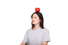 Cute woman with apple on head, isolated on white Royalty Free Stock Image
