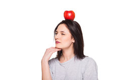 Cute woman with apple on head, isolated on white stock photo