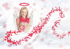 Cute woman as cupid. Young blond smiling woman as cute cupid witch small hearts royalty free stock photos