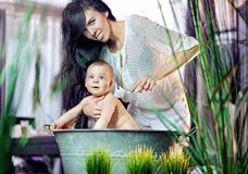 Cute woman with baby Stock Images