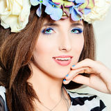 Cute Woman. Beautiful Blue Makeup. Hair with Flowers. Cute Woman. Beautiful Blue Makeup. Hair with Summer Flowers Royalty Free Stock Image