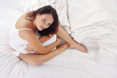Cute woman in bed Stock Image