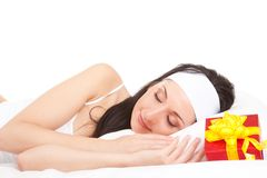 Cute woman on the bed with gift box Stock Image