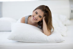 Cute woman on the bed at home Stock Photography