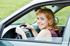 A cute woman behind the wheel Stock Photos