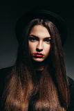 Cute woman in black hat with long hair Stock Photography
