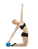 Cute woman in black training with ball royalty free stock photo