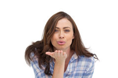 Cute woman blowing a kiss to the camera Stock Photos