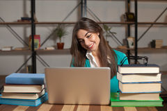 Cute woman with books Stock Images