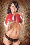 Cute woman boxing topless wearing black panties. Ready to fight Royalty Free Stock Images