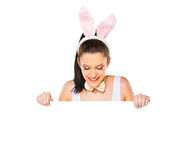 Cute woman with bunny ears holding a white blank sign Royalty Free Stock Photo